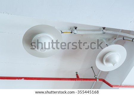Cell mobile phone equipment antenna telecommunications transmitters wireless communication installed at ceiling - stock photo