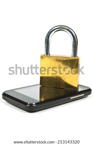 Cell phone beside it a large metal padlock - stock photo