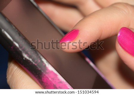 Cell phone in hand. macro - stock photo