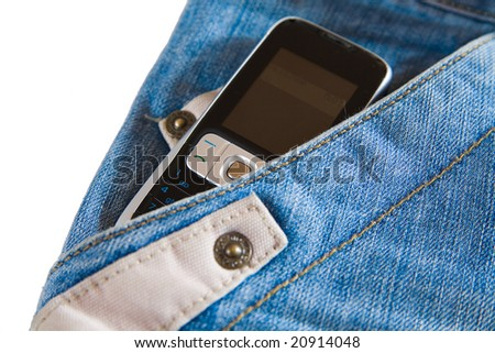 cell phone in pocket of modern fashionable jeans - stock photo