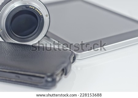 cell phone, lens for SLR camera and tablet PC