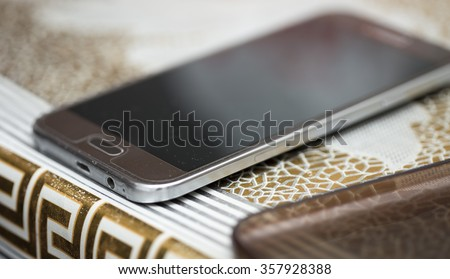 cell phone on the table - stock photo