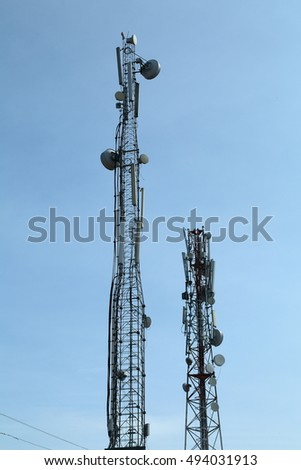 Cell phone tower in blue  sky background.