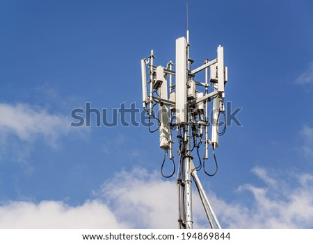 Cell Phone Tower on blue sky - stock photo