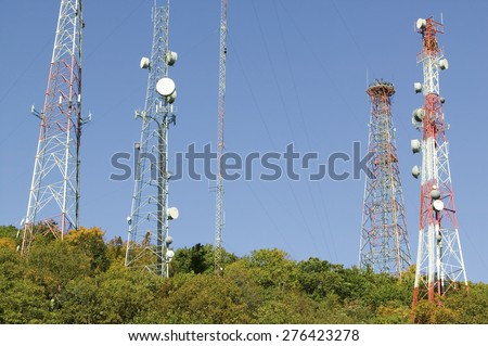 Cell phone towers line highway 95 North of Richmond Virginia - stock photo