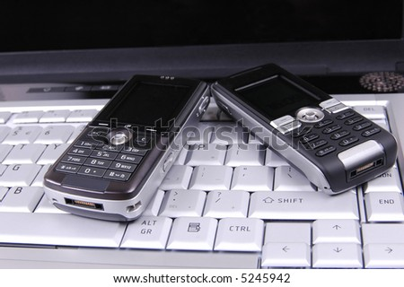 Cell phones on keyboard