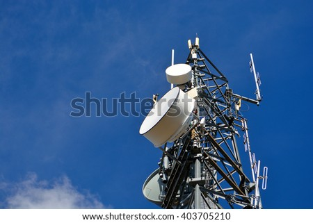 Cell Tower With Microwave Dishes At A Low Angle - stock photo