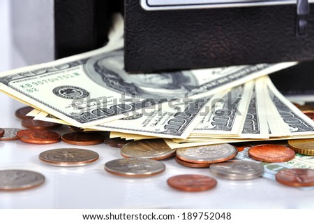 cell with money in safety deposit box - stock photo
