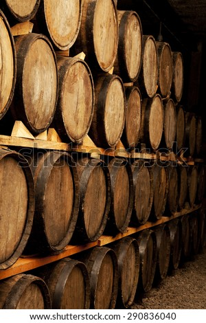 cellar with barrels of wine without labels - stock photo