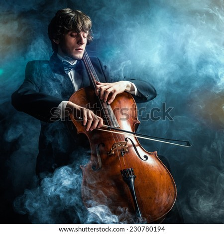 cellist in smoke - stock photo