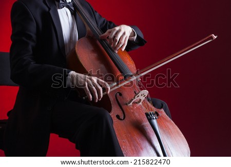 Cellist playing classical music on cello - stock photo