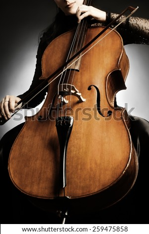 Cello music instrument orchestra player cellist playing classic. Closeup of cello with bow in hands - stock photo