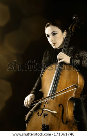 Cello orchestra musical instrument player. Cellist classical music playing.