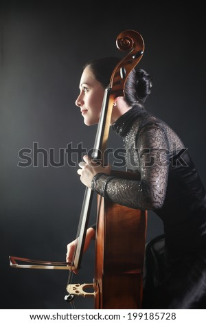 Cello player cellist playing orchestra Classical musician with musical instrument