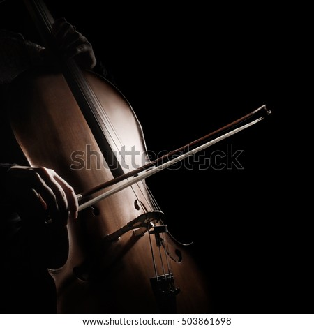 Cello player cellist playing orchestra musical instrument close up violoncello