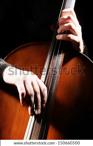 Cello playing cellist hands details. Orchestra musical instruments - stock photo