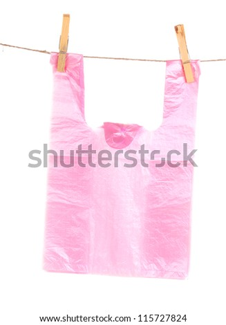 Cellophane bag hanging on rope isolated on white - stock photo