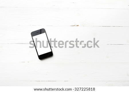 cellphone over white table - stock photo