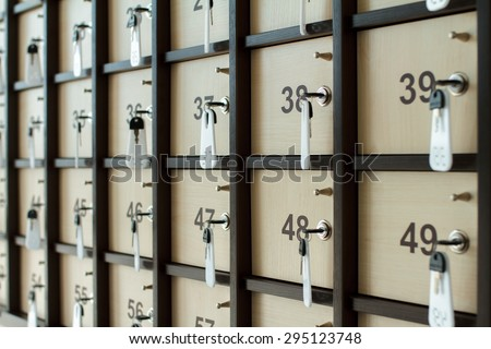 Cells in a luggage office with keys - stock photo