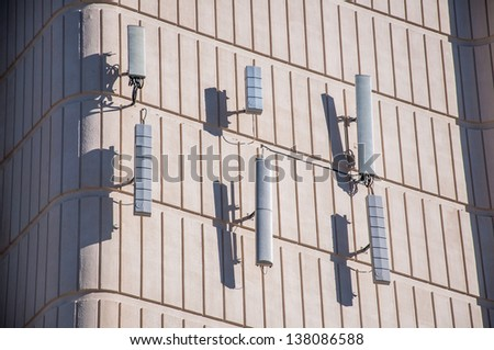 Cellular antenna mounted to the wall of building.