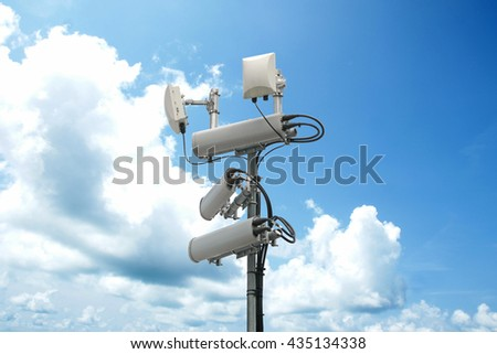 Cellular network antenna with wifi hotspot repeater and blue sky. - stock photo