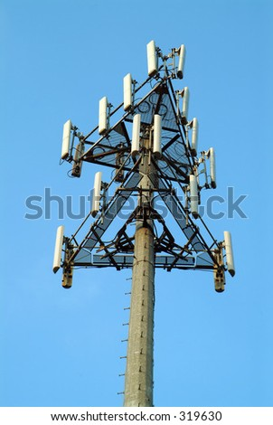 Cellular phone tower with bright blue sky