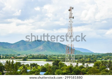 Cellular tower and mountain background. - stock photo