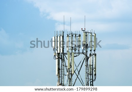 Cellular tower over blue sky - stock photo