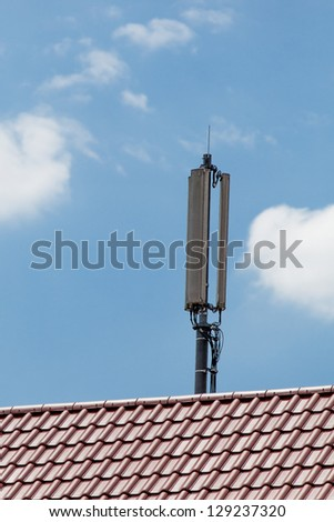 Cellulra Network Antenna on a red roof - stock photo