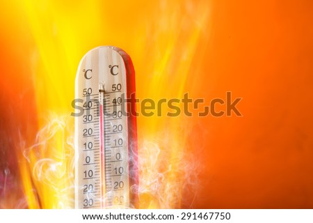 Celsius thermomether with fire flames, hot weather. - stock photo