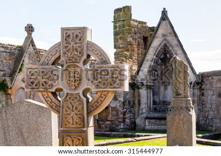celtic cross on a graveyard at st. andrews, scotland