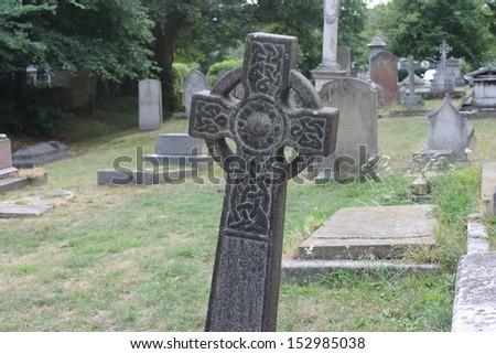 Celtic Gaelic stone cross in cemetery graveyard - stock photo
