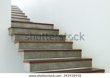cement and wood staircase on white mortar wall, design interior in modern house