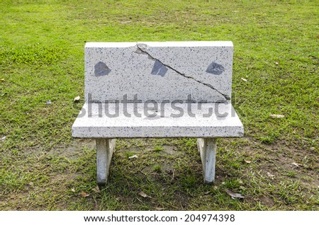 Cement bench alone in the garden  - stock photo
