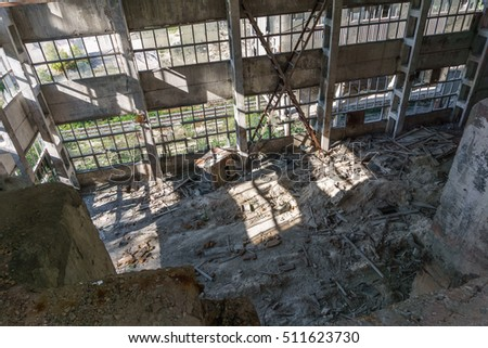 Cement Factory Abandoned building. Dirty and big Interior. View from inside.