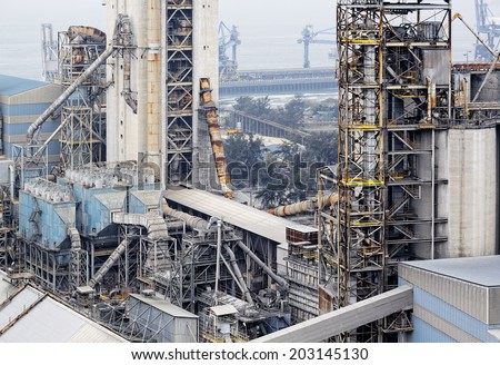 cement factory close up at day - stock photo