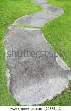 cement floor walk path with green grass