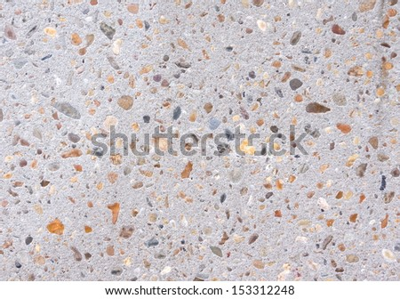 cement floor with little colorful stones attached  - stock photo