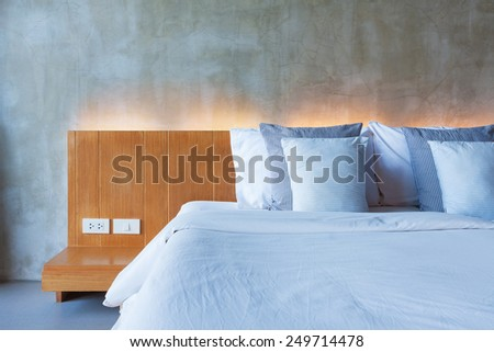 cement interior style in bedroom, modern wood bed. - stock photo
