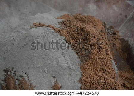 cement mix concrete is compacted sand. Waiting to be mixed with cement, Cement mixer machine at construction site, tools and sand