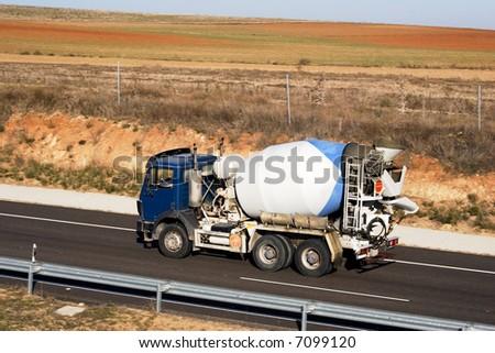 Cement mixer on highway - stock photo