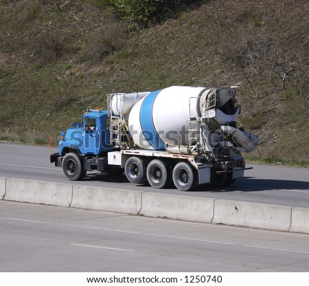 Cement Mixer Truck on the Highway - stock photo