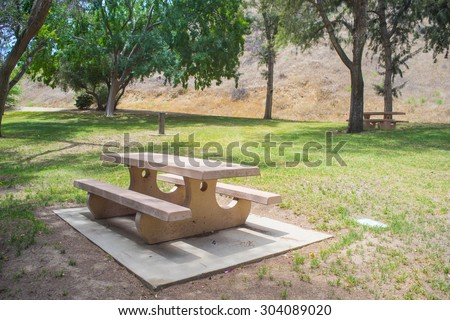 Cement picnic table sitting on a pad in Val Verde, California. - stock photo