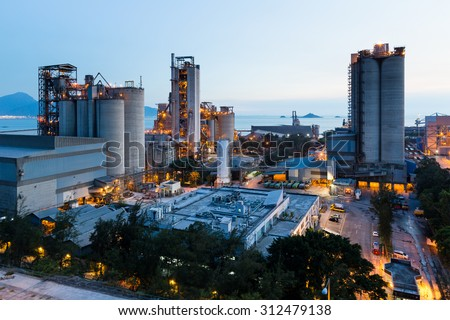 Cement Plant and power sation in sunset - stock photo