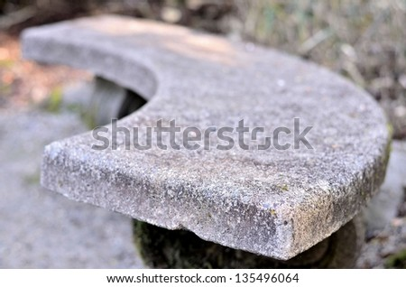 Cement seat side view - stock photo