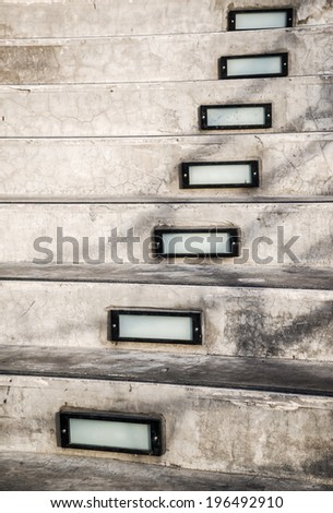 Cement staircase with illuminated box - stock photo