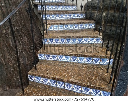 Cement Steps With Tiles And Railing
