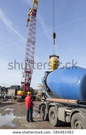 cement truck unloading on construction site and blue sky