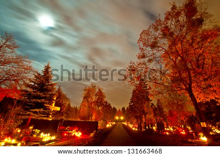 Cemetery alley at night, All Saints Day, Wroclaw, Poland - stock photo