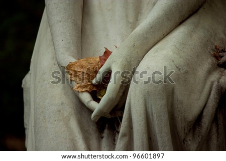 Cemetery and graves, stone angel and vase - stock photo